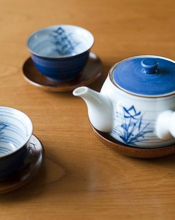 relaxing the body - tea cups and a teapot for a refreshing cup of green tea